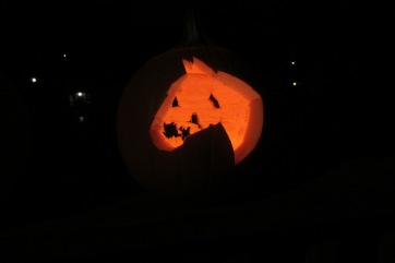 Grace's pumpkin, a horse, with a jack-o-lantern face on the other side.