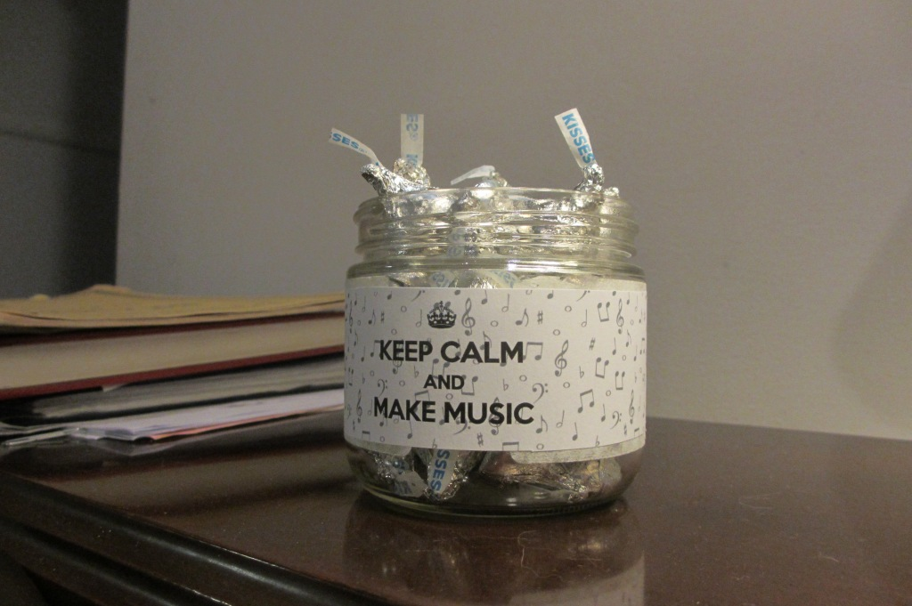 Jar of Hershey's Kisses for my piano student.  My teacher has one on her piano, so I found a nice-looking jar in the cabinet, made a band to go around it, and voila!
